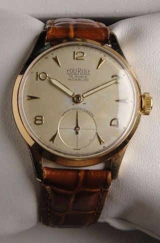 Elegante Vintage Armbanduhr Tourist – Handaufzug – Wehrmachtswerk Cal.  As 1130 Bild