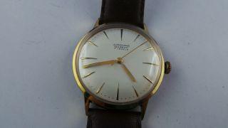 Junghans Trilastic Armbanduhr,  17 Jewels,  Handaufzug,  Topzustand Bild