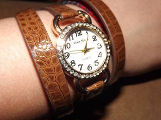 Schicke Damen Quarz Armbanduhr Braun Wickelband Strass Bild