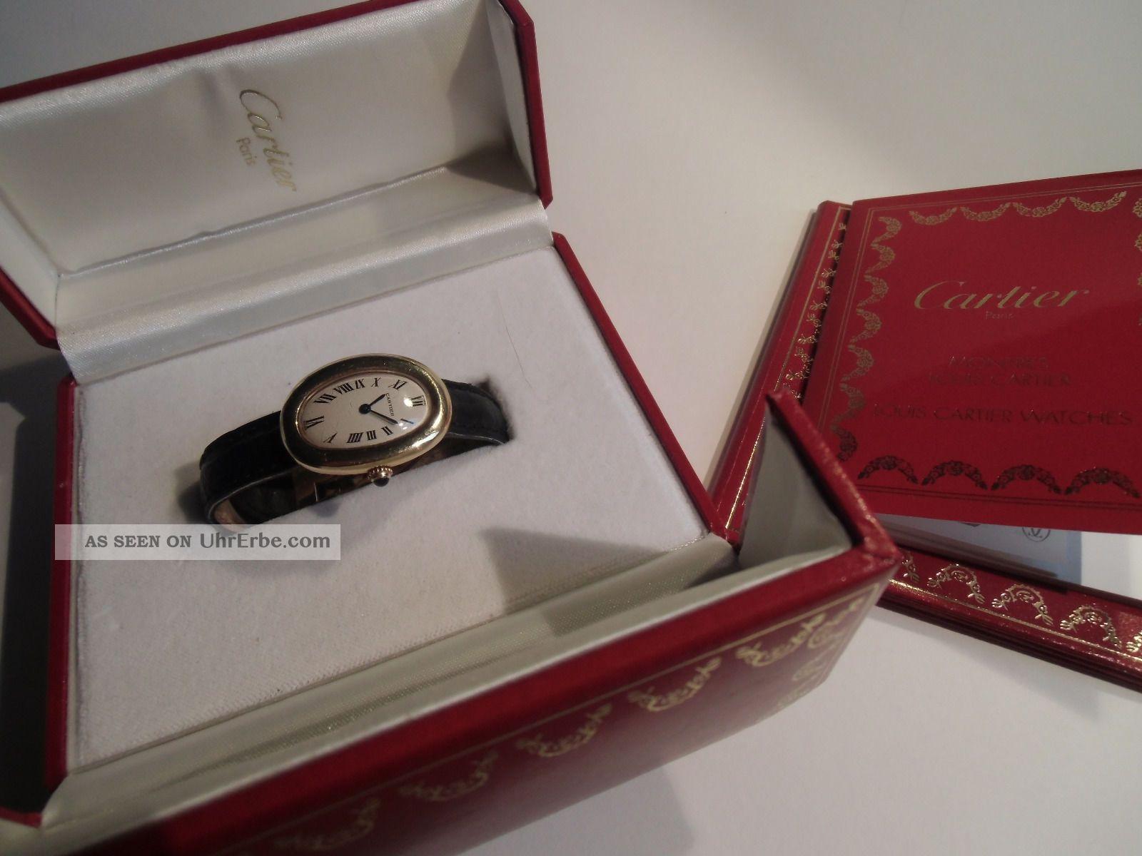 Goldene Damen - Armbanduhr,  Cartier Baignoire Armbanduhren Bild