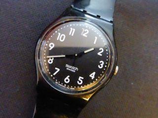 Swatch Uhr Schwarz Bild