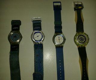 4 Swatch Armbanduhren Bild