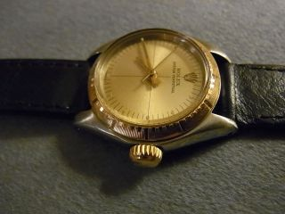 Damenluxusuhr Rolex Modell Oyster Perpetual No Date Stahl/gold, Bild