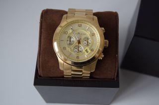Michael Kors Armbanduhr Runway Mk8077 Gold Chronograph Damenuhr Herrenuhr Bild