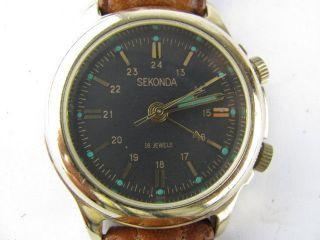 Sekonda/ Edelstahl Handaufzug Herrenuhr / Vintage / Wecker / Lederarmband Bild
